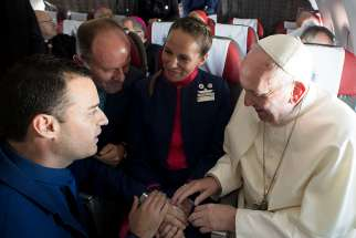 Pope Francis performs an impromptu wedding ceremony for Latam Airlines employees Carlos Ciuffardi Elorriaga, 41, and Paula Podest Ruiz, 39, aboard the pontiff's flight from Santiago, Chile, to Iquique Jan. 18.