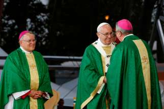 Pope Francis greets Dublin Archbishop Diarmuid Martin during the closing Mass of the World Meeting of Families on Benjamin Franklin Parkway in Philadelphia Sept. 27. The 2108 World Meeting of Families is to be held in Dublin. Looking on is Archbishop Charles J. Chaput of Philadelphia.