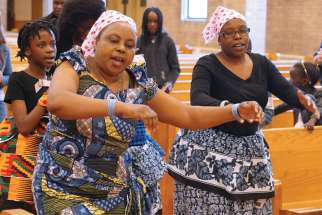 For Elizabeth Muturi, left, the sights and sounds of a Swahili Mass at St. Andrew's in Edmonton were a dream come true.