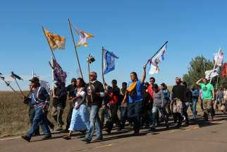 Several hundred people took part in a prayer walk on Sept. 14, 2016, from the Oceti Sakowin camp near Standing Rock Reservation in North Dakota to the site up the road where Dakota Access began digging over Labor Day weekend for construction on a nearly 1,200-mile pipeline project. Construction temporarily has been halted.