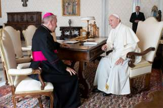 Archbishop Luigi Ventura meets with Pope Francis at the Vatican in 2018.