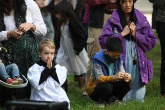 Maxxis Brehm, 4, prays for peace and justice during a rosary led by Archbishop Alexander K. Sample of Portland, Ore., Oct. 17, 2020.