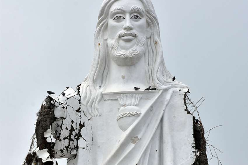 A damaged statue of Jesus Christ is seen Nov. 16 in Velankanni, India, after Cyclone Gaja hit the region that same day. More than 40 people were killed and some 82,000 displaced in state-run relief camps.