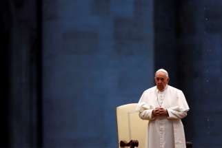 "Pope Francis leads a prayer service in an empty St. Peter's Square at the Vatican March 27, 2020. ""What we are living now is a place of 'metanoia' (conversion), and we have the chance to begin,"" Pope Francis said in an interview about the COVID-19 pandemic, published April 8."