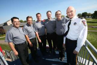 Scott Knight, right, Chaska police chief and member of the Basilica of St. Mary in Minneapolis, stands with pastors of Chaska churches who will serve as chaplains at the Ryder Cup golf tournament at Hazeltine National Golf Club in Chaska beginning Sept. 27.