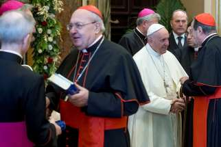Pope Francis greets prelates during his annual pre-Christmas meeting with top officials of the Roman Curia and Vatican City State and with cardinals living in Rome in the Clementine Hall Dec. 21 at the Vatican.
