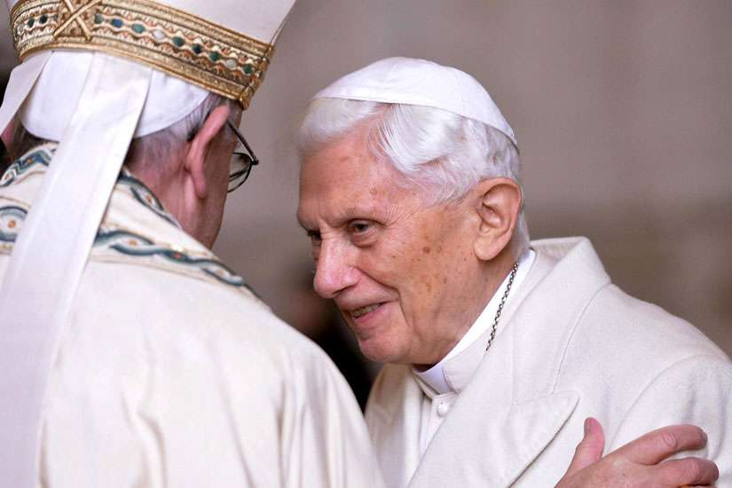 Pope Francis greets retired Pope Benedict XVI prior to the opening of the Holy Door of St. Peter's Basilica at the Vatican in 2015.