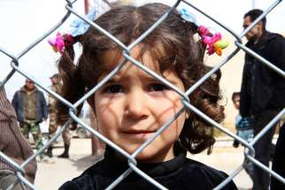 A displaced Syrian girl finds temporary shelter at a school in Damascus, Syria, Feb. 23. A prominent Syrian Christian political leader has called for U.S.-led coalition forces to use airstrikes to aid fellow Syrian Christian and Kurdish fighters battling Islamic State militants in northwest Syria following reports of flagrant abductions and church burnings.