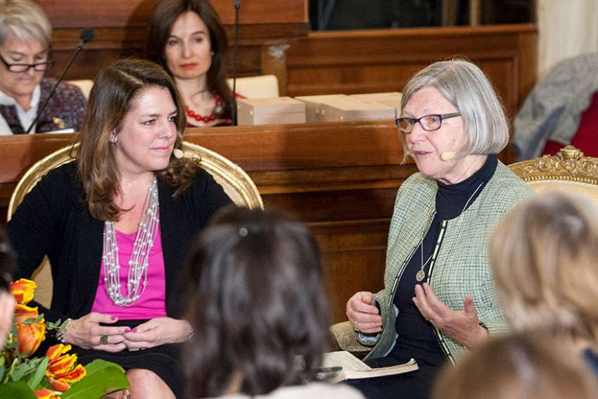 "Kerry Alys Robinson and Sister Simone Campbell, a Sister of Social Service, speak during the Voices of Faith gathering March 8 at the Vatican. The event, held on International Women's Day, had the theme ""Stirring the Waters-Making the Impossible Possible."""