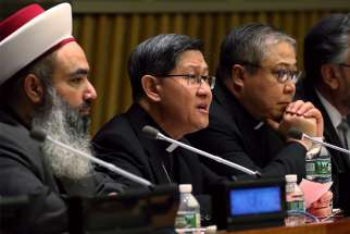 Cardinal Luis Antonio Tagle of Manila, Philippines, speaks during an interfaith conference on migrants and refugees at the U.N. headquarters in New York May 3. The event was co-hosted by the Permanent Mission of the Holy See to the U.N. and Caritas Internationalis.