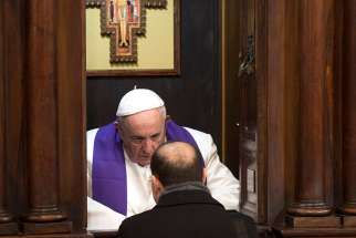 Pope Francis hears confession during his annual Lenten meeting with the pastors of Rome parishes Feb. 15.