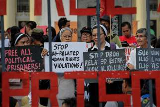 Nuns hold placards as they stage a demonstration to mark International Human Rights Day in Manila, Philippines, Dec. 10, 2016.