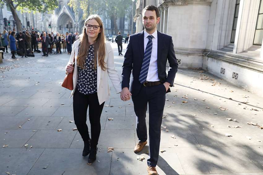 Daniel and Amy McArthur, owners of Ashers bakery in Belfast, Northern Ireland, leave the Supreme Court in London Oct. 10. The court upheld their right to refuse to make a cake emblazoned with a slogan in support of same-sex marriage.
