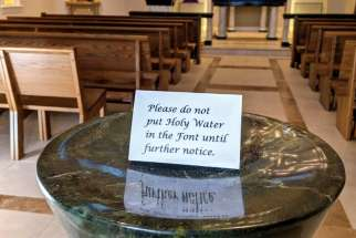 An empty holy water font at the John Paul II Pastoral Centre in Vancouver. Parishes in the Archdiocese of Vancouver have begun cancelling events in response to the coronavirus outbreak.