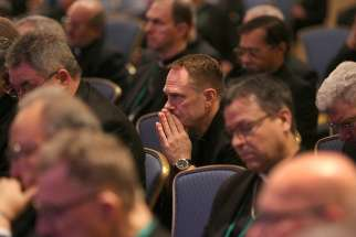 Prelates pray before the Blessed Sacrament in the chapel during a day of prayer Nov. 12 at the fall general assembly of the U.S. Conference of Catholic Bishops in Baltimore.