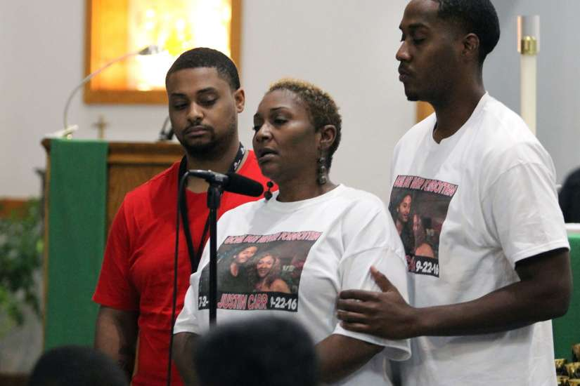 Vivian Carr and her sons Kenneth Johnston and Ellis Carr speak during a Sept. 23 prayer service at Our Lady of Consolation Catholic Church in Charlotte, N.C. The previous day Vivian's other son, Justin Carr, died from a gunshot wound to the head that he received during protests in Charlotte which turned violent following the fatal police shooting of an African-American man.