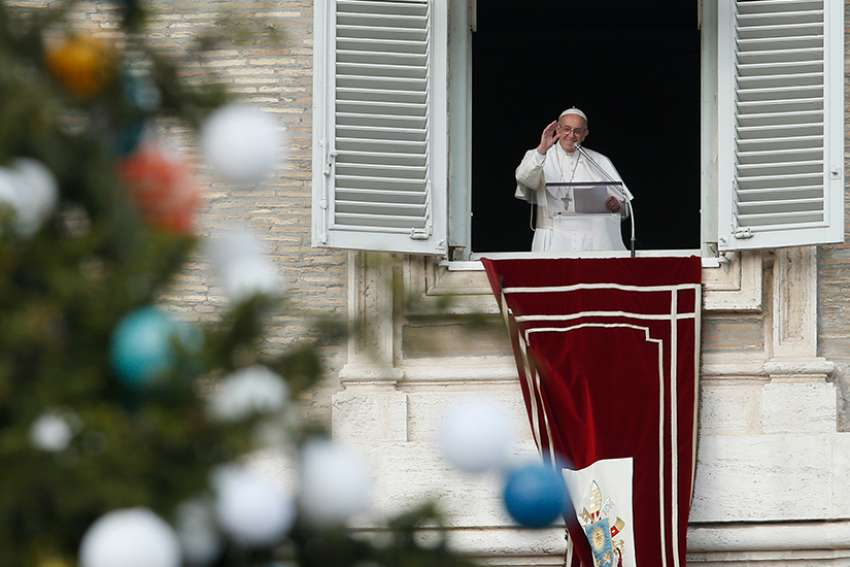 Pope Francis leads the Angelus from the window of his studio overlooking St. Peter's Square at the Vatican Dec. 8, the feast of the Immaculate Conception.