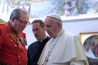 Pope Francis talks with Fra Matthew Festing, grand master of the Sovereign Military Order of Malta in 2016. Bob Brehl says there's more to the tension between the Vatican and Malta than meets the eye.
