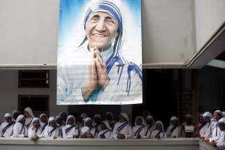 A poster of Blessed Teresa of Kolkata and Missionaries of Charity are seen in Calcutta, India, in this Sept. 5, 2007, file photo. Pope Francis will declare her a saint at the Vatican Sept. 4, the conclusion of the Year of Mercy jubilee for those engaged in works of mercy.