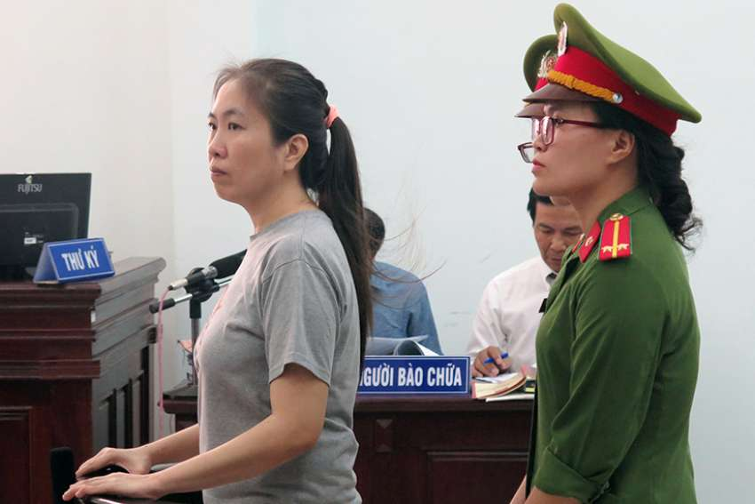 "Vietnamese blogger Nguyen Ngoc Nhu Quynh, who is known as ""Mother Mushroom,"" stands during her 2017 trial in Nha Trang. Vietnam has freed the well-known Catholic blogger and rights activist jailed two years ago for posting anti-government material on social media and forced her into exile in the United States."
