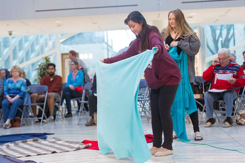 Student volunteers prepare for a Kairos Blanket Exercise at Edmonton City Hall in 2016. The Exercise was created as an interactive way of learning Indigenous history.