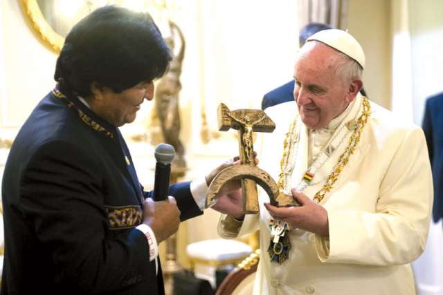 Bolivian President Evo Morales presents a gift to Pope Francis at the government palace in La Paz, Bolivia, July 8. The gift was a wooden hammer and sickle ­— the symbol of communism — with a figure of a crucified Christ.