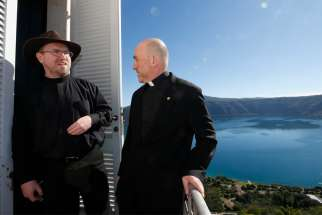 "Jesuit Brother Bob Macke and Jesuit Father Gabriele Gionti, an astronomer, prepare to give journalists a tour of the Vatican Observatory at the papal villa at Castel Gandolfo, Italy, Sept. 28, 2018. Brother Macke said that by studying the universe, ""we can better appreciate the God who created it."""