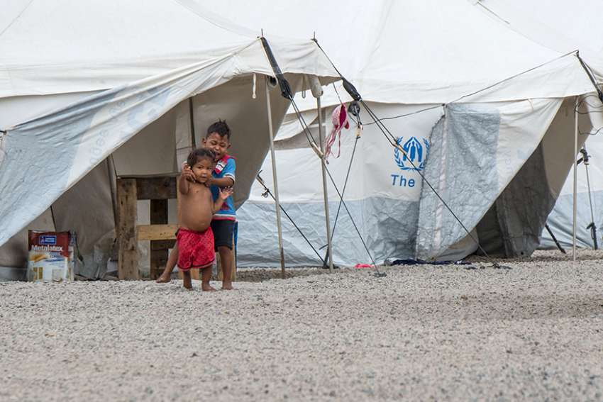Kids play among the refugee tents at Abrigo One in Boa Vista, Brazil, Feb. 18.
