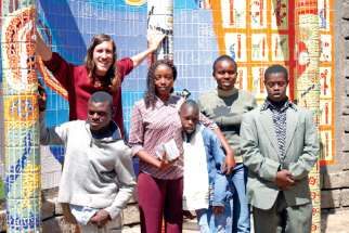 Michael McDonald with L'Arche Kenya residents in 2011.