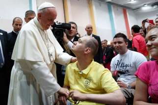 Pope Francis greets a young man during a meeting with youth at the diocesan John Paul II Youth Center in Sarajevo, Bosnia-Herzegovina, June 6. The pope made a one-day visit to Bosnia-Herzegovina to encourage the minority Catholic community in the faith and to foster dialogue and peace in a nation still largely divided along ethnic lines.