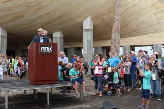 Answers in Genesis President and Co-Founder Ken Ham speaks during a press conference, ringed by supporters, before a ribbon cutting event at the foot of the full-scale Noah's Ark replica at the Ark Encounter on July 5, 2016, in Williamstown, Ky.