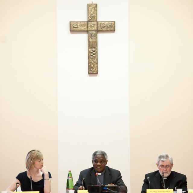 Moderator Julie Etchingham, a British TV journalist, Cardinal Peter Turkson, president of the Pontifical Council for Justice and Peace, and Msgr. Patrick Lynch, chair of the office for migration policy at the Bishops' Conference of England and Wales, att end a Vatican conference on combating human trafficking May 8.