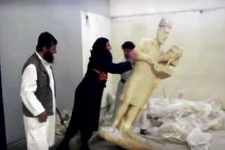 Members of the Islamic State destroy ancient artifacts in Iraq.