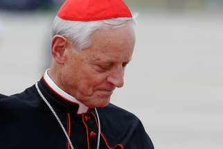 Cardinal Donald W. Wuerl is pictured as he waits for Pope Francis' arrival at Andrews Air Force Base in Maryland near Washington Sept. 22, 2015.