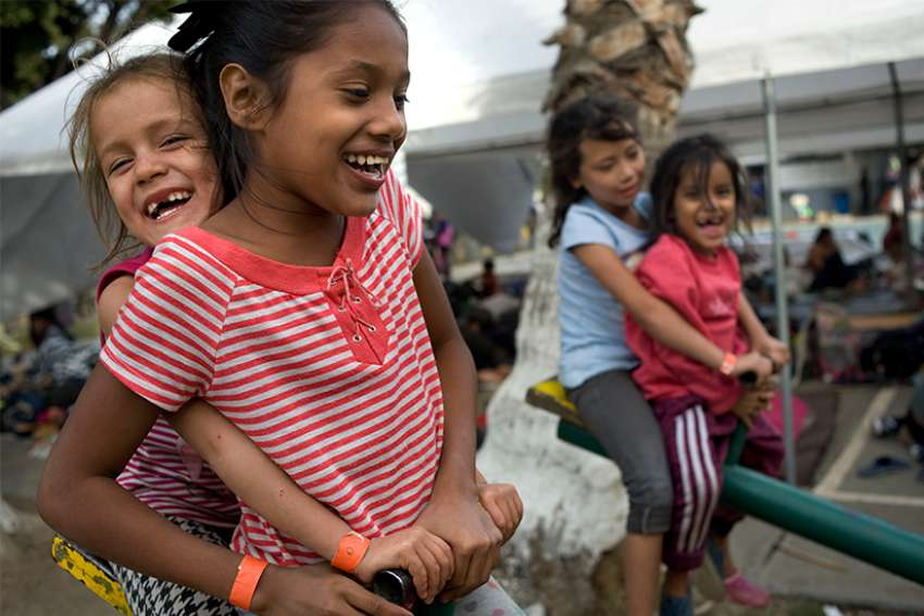 Children play at a camp at a sports facility in Tijuana, Mexico, set up to for people arriving Nov. 15 in a caravan of Central American migrants at the U.S.-Mexico border.