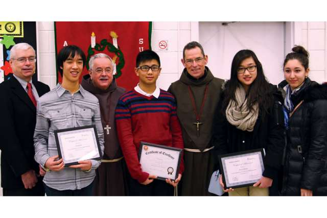 Winners of the Week of Prayer for Christian unity writing contest at St. Joan of Arc parish in Toronto. From left, The Catholic Register publisher Jim O'Leary, first-place winner Nathan Ko, Fr. Damian MacPherson, honourable mention Lawrence P. Fraginal, Fr. Daniel P. Callahan, second-place Kelly Cheung and honourable mention Daniela D. Tarzia.