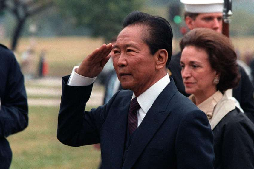 former president of the Philippines, Ferdinand Marcos, the dictator ousted in the 1986 People Power revolution, was secretly given military honors before burial at the Heroes' Cemetery.