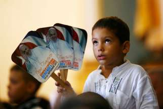 A child attends a meeting with Pope Francis at the Cathedral of Our Lady of the Assumption in Santiago, Cuba, Sept. 22.