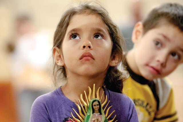 Five-year-old Nicole Vicente holds a statue of Our Lady of Guadalupe to be blessed during a Dec. 11 Mass celebrating the anniversary of the appearance of Mary to St. Juan Diego in 1531. The Mass was celebrated at St. Joseph Church in Penfield, N.Y.