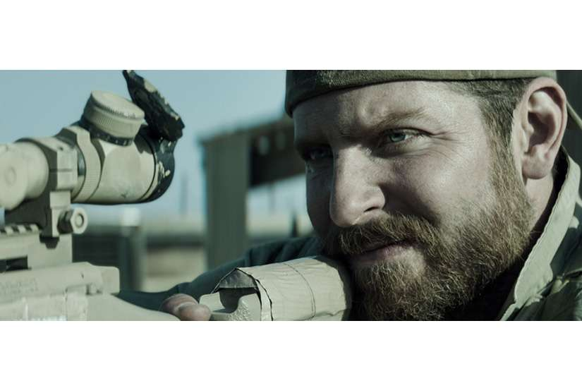 "Bradley Cooper as Chris Kyle in Warner Bros. Pictures' and Village Roadshow Pictures' drama ""American Sniper."""