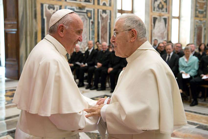 Pope Francis greets Norbertine Father Bernard Ardura, president of the Pontifical Committee for Historical Sciences, March 31 at the Vatican. The pope met with scholars taking part in a Vatican-sponsored congress on the Lutheran Reformation as part of the 500th anniversary commemorating the start of Luther's call for reform.