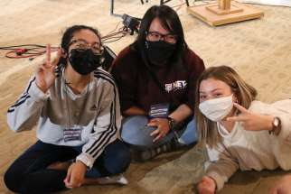Monica Palacios, left, Pia Ocenar and Theresa Henry were among the 46 young Catholics who spent five weeks at the Sanctum Retreat Centre learning how to become NET Canada missionaries. Health and safety protocols did not dim the orientation experience.