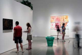 "Patrons peruse the artwork in ""Back to Eden: Contemporary Artists Wander the Garden,"" an exhibit at New York's Museum of Biblical Art."