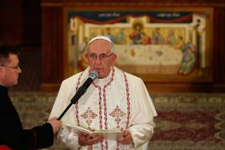 Pope Francis speaks while meeting with Chaldean Catholics at the Church of St. Simon the Tanner in Tbilisi, Georgia, Sept. 30.