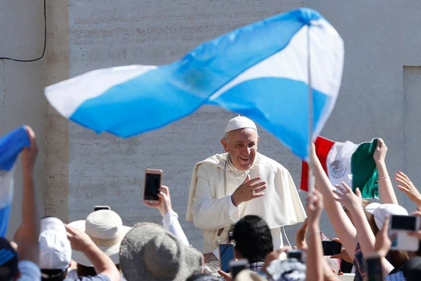 Argentina's flag is seen as Pope Francis greets the crowd during his general audience in St. Peter's Square at the Vatican June 27.