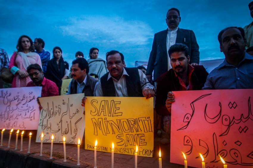 Pakistani Christian minority and civil society activists light candles at a 2014 protest in Karachi, Pakistan, against the killing of a Christian couple accused of blasphemy. Supporters of Pakistan's blasphemy law were stopped Jan. 4 from holding a rally.