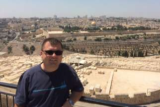 Fr. Tomasz Dzida, 34, associate pastor of Scarborough's Our Lady Queen of Poland, seen here in Jerusalem on Aug. 22, suffered a stroke while on pilgrimage in the Middle East, Aug. 27.