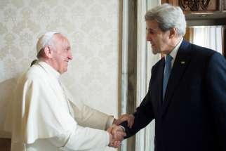 Pope Francis greets U.S. Secretary of State John Kerry during a private meeting at the Vatican Dec. 2.