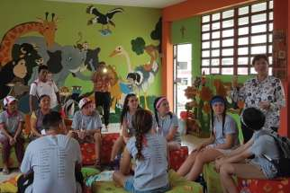 Sr. Patricia Laughlin, principal of Fe y Alegria 58, prepares the Canadian students before the first day back to school.