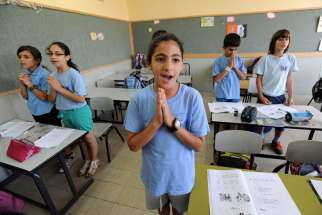 Israeli-Arab fourth-grade students pray in Aramaic during language class in 2012 at Jish Elementary School in Israel. Dozens of Christian schools in Israel may be shutting their doors this coming school year due to increasing restrictions by the Israeli government, Christian educators warn.
